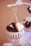 Groom and bride shape cookies Stock Photos
