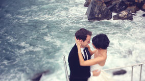 Groom and bride on the shore Stock Photography