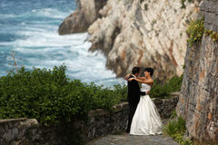 Groom and bride on the shore Royalty Free Stock Photography