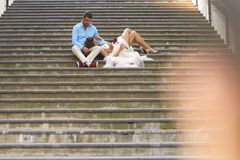 Groom and bride sitting on stairs Stock Images