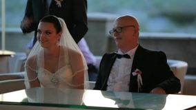 Groom And Bride Sitting At Table stock video footage