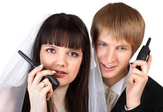 Groom and bride speak on radio isolated Royalty Free Stock Photos