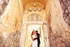 Groom and bride on stairs in a hallway Royalty Free Stock Photos
