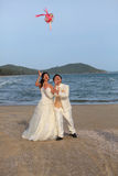 groom and bride standing with bouquet flowers at Stock Photo