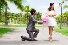 Groom and bride standing with bouquet flowers Royalty Free Stock Photography