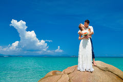 Groom and bride standing with bouquet flowers Stock Photography