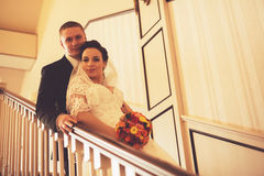 Groom and bride standing on stairs. At home Stock Images