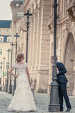 Groom and bride on street Stock Photos