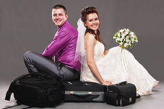 Groom and bride in a studio Royalty Free Stock Image