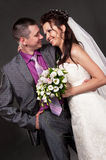 Groom and bride in a studio Royalty Free Stock Photos
