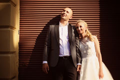 Groom and bride on a sunny day stock photo
