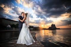 Groom, bride, sunset, beach royalty free stock photos