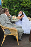 The groom and the bride talk at the table Stock Photography