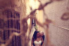Groom and bride on a tight street Stock Photo