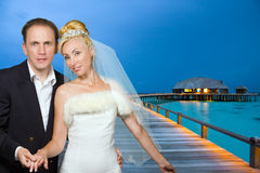 The groom and the bride on the tropical beach Royalty Free Stock Images