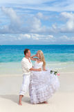 The groom and the bride on the tropical beach Royalty Free Stock Image