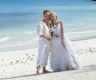 The groom and the bride on the tropical beach. Stock Image
