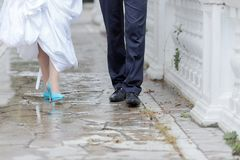 Groom and bride walking in the park in rainy day Stock Photo