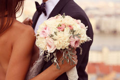 Groom and bride with wedding bouquet Royalty Free Stock Photo