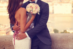 Groom and bride with wedding bouquet Stock Photo