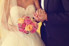 Groom and bride with wedding bouquet Stock Photos