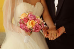 Groom and bride with wedding bouquet Stock Images