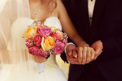 Groom and bride with wedding bouquet Stock Photography