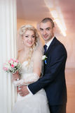 Groom and the bride with a wedding bouquet Royalty Free Stock Photography