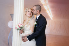 Groom and the bride with a wedding bouquet Stock Image