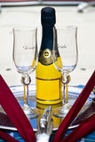 Groom & Bride Wedding Glasses and Champagne Bottle. Groom & Bride Wedding Glasses with Yellow Champagne Bottle on a Silver Plate Royalty Free Stock Photos