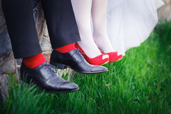 Groom. bride, wedding shoes, red Royalty Free Stock Image
