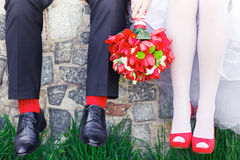 Groom. bride, wedding shoes, red Royalty Free Stock Photo