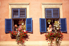 Groom and bride on the window Royalty Free Stock Photos