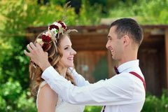 Groom with bride a wreath of flowers Stock Image