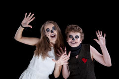 Groom and bride - zombie. Children have put on for Halloween stock image