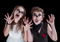 Groom and bride - zombie. Children have put on for Halloween royalty free stock images