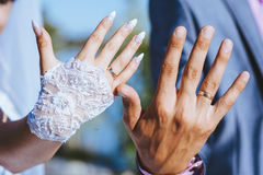 Groom and brides hands with rings, closeup view Stock Images