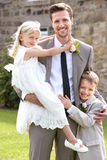 Groom With Bridesmaid And Page Boy At Wedding. Smiling To Camera Royalty Free Stock Images