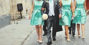 Groom and bridesmaid walking street. Wedding picture.  Groom and bridesmaid walking street Stock Photo