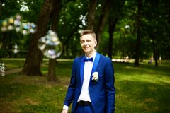 Groom with bubble on wedding Stock Photos