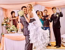 Groom  carries bride on his hands Stock Photo