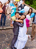 Groom carries his bride over shoulder. Royalty Free Stock Photos