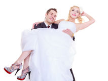 Groom carry bride in his arms Royalty Free Stock Images