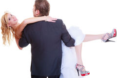 Groom carry bride in his arms Royalty Free Stock Photos