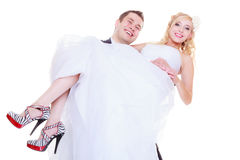 Groom carry bride in his arms Stock Photos