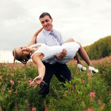 Groom carry a bride Royalty Free Stock Image