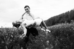 Groom carry a bride Royalty Free Stock Photography