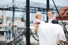 Groom carrying his beautiful bride Royalty Free Stock Photography