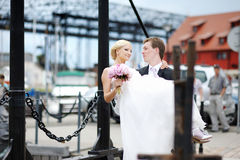 Groom carrying his beautiful bride Stock Photography