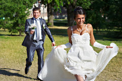 Groom catches bride at a wedding walk Royalty Free Stock Images